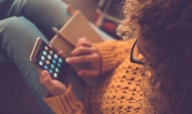 girl checking social media on her phone