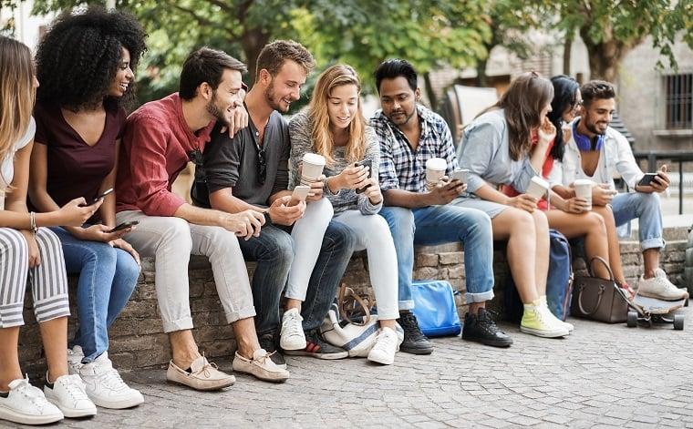 group-of-friends-using-mobile-phones-outdoors-in-c-2021-05-05-19-32-55-utc-jpg